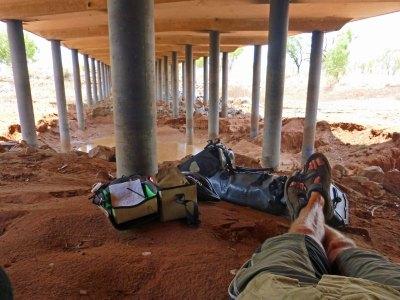 Taking refuge under a bridge